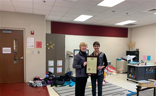 State Rep Deb Lavender presents award to Lori Wehrman Teacher of the Year.